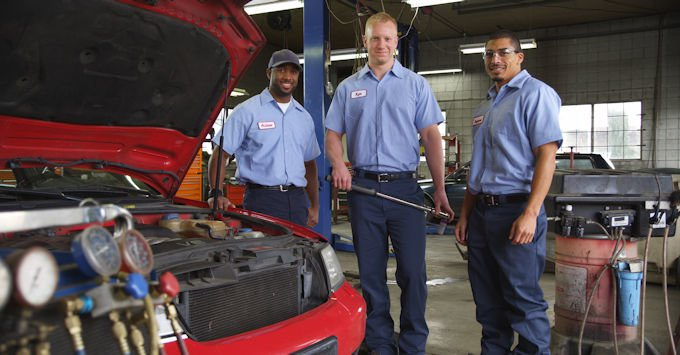 Three auto mechanics
